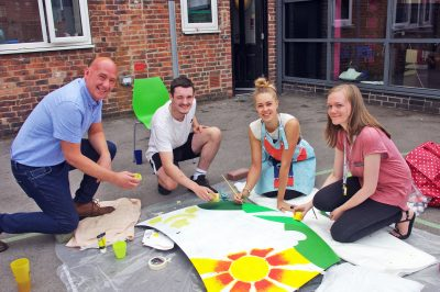 SDE Group's Jonathan Bennett Roundabout service user Callum Finn artist Laura Kennedy and Roundabout relief worker Rebecca Newbould