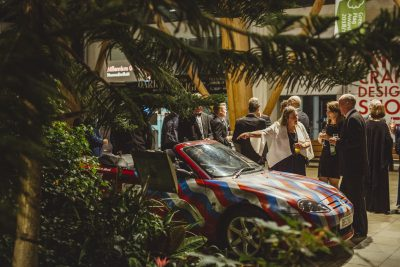 The Henry Boot Construction rally team's MG Convertible painted by artist Rob Lee on display during the evening reception in the Winter Garden