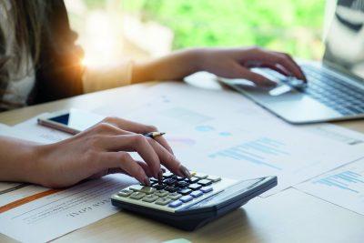 Laptop Calculator and Paperwork
