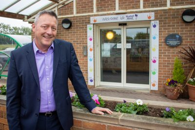 CEO Simon outside hospice