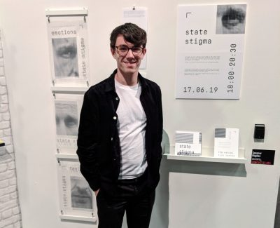 Spencer Hughes with his graphic work at the Barnsley College Art Design and Fashion End of Year Show
