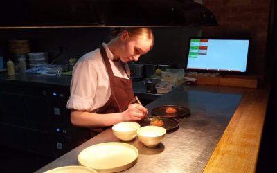 Beata preparing food at Roots restaurant in York.