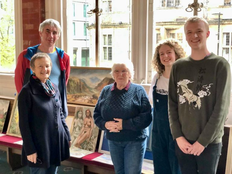 Joyce Spurr Exhibition 12.10.2019 (Gary Simmonds, lecturer, with current and former students in front of a selection of Joyce Sp