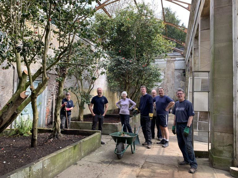 Wentworth Camellia House with garden volunteers (c) WWPT