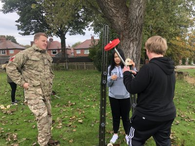 Public Services students with a British Army representative.