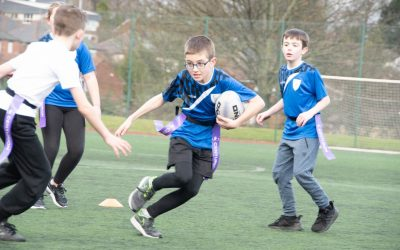A Kexborough Primary School pupil running with the ball_