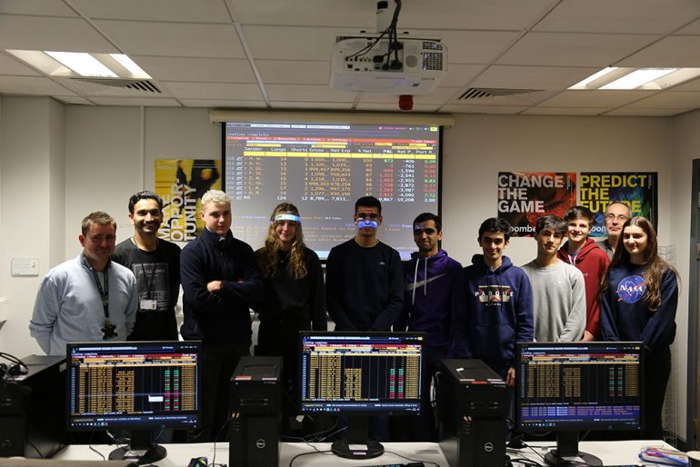 From left lecturers Drew Woodhouse Firoz-Bhaiyat students from Birkdale School and Gary Stead senior lecturer in accounting