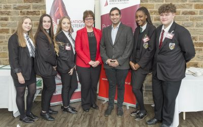 Baasit Siddiqui and Cllr Tricia Gilby with pupils from Whittington Green School